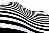 Modern architecture in Serbia. Waves facade design. Building in the shape of a flag.