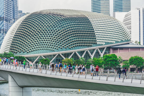 Modern architecture in Singapore - The Esplanade The Esplanade is a massive performing arts center located in the Marina Bay of Singapore. This photo captures the ultra modern building and it's surroundings on a warm sunny day. esplanade theater stock pictures, royalty-free photos & images
