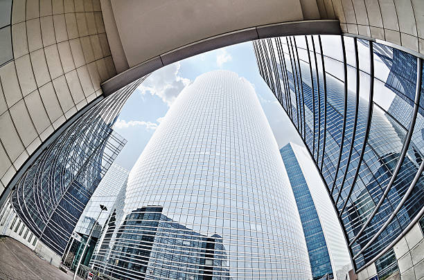 Modern architecture in the business district of La Defense Large skyscrapers shot with a fisheye lens La Defense major business district near Paris, France fish eye lens stock pictures, royalty-free photos & images