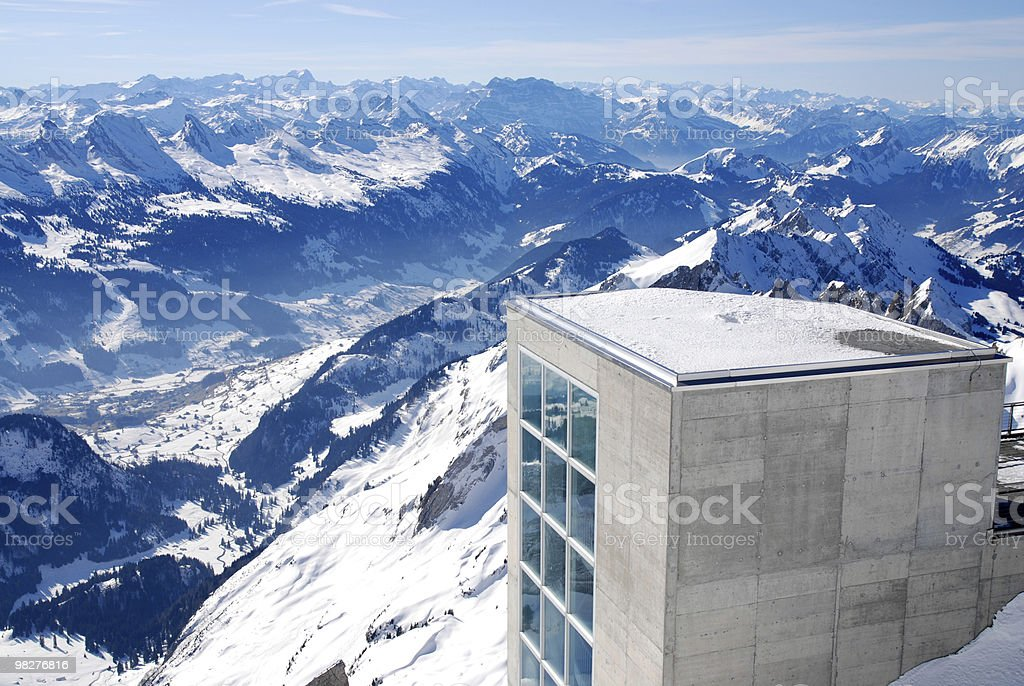 Modern architecture on snowy mountain juxtaposed with nature royalty-free stock photo