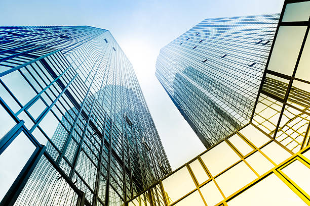 Modern Architecture The sky's the limit: looking up, futuristic glass and steel architecture, strong contrast, toned generic description stock pictures, royalty-free photos & images