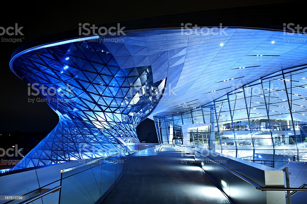 Modern architecture with blue lights at night stock photo
