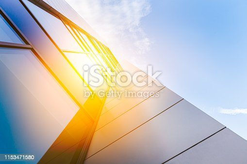 647236352 istock photo Modern architecture with sun 1153471580