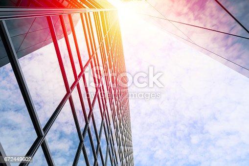 647236352 istock photo Modern architecture with sun 672449602