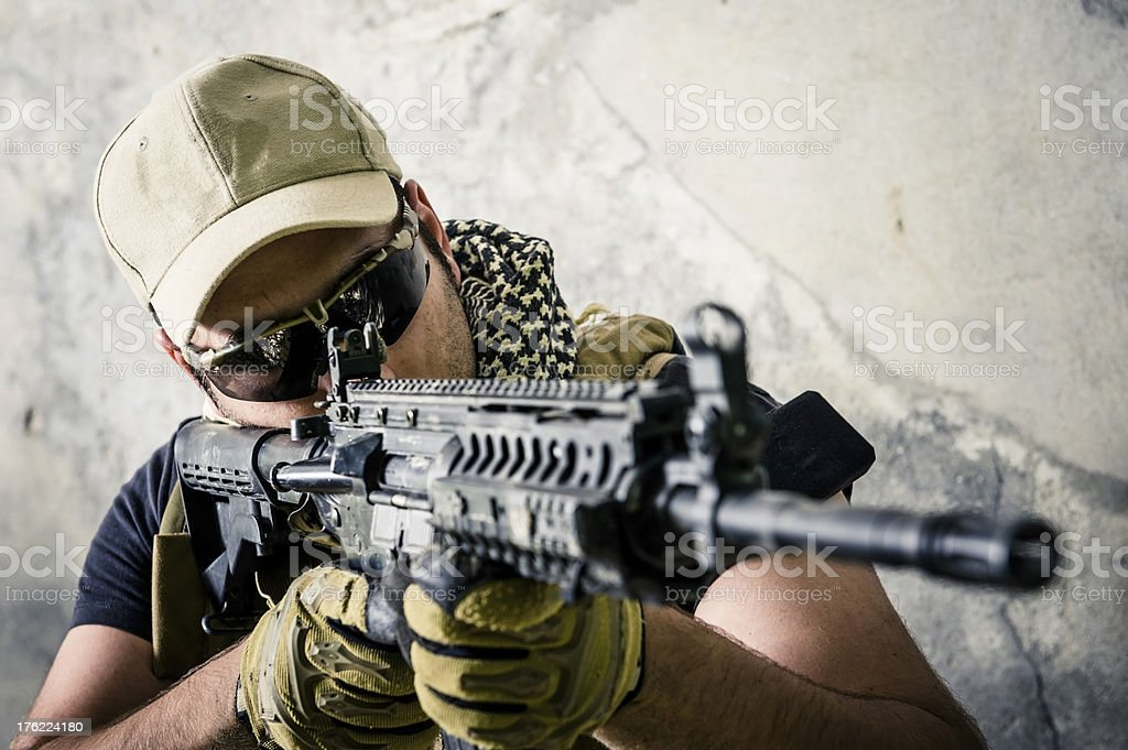 Modern Army Soldier Aiming and Shooting with Automatic Assault Rifle stock photo
