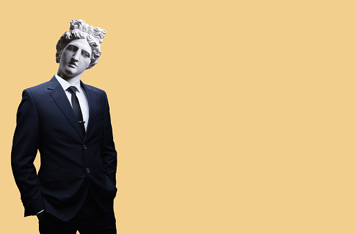 Modern art collage. Concept portrait of a  businessman .Gypsum head of of Apollo. Man in suit.