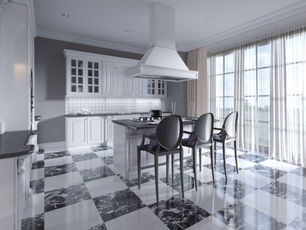 Modern art deco style kitchen with trendy black and white furniture and a chess marble floor. Kitchen island, bar stool.