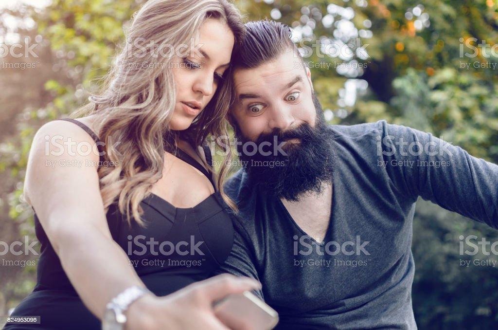 modern attractive couple making selfie stock photo