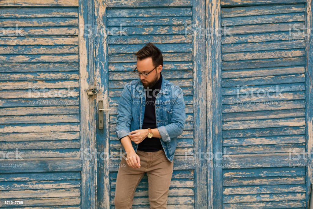 Modern attractive guy posing outdoors.Fashion concept. stock photo