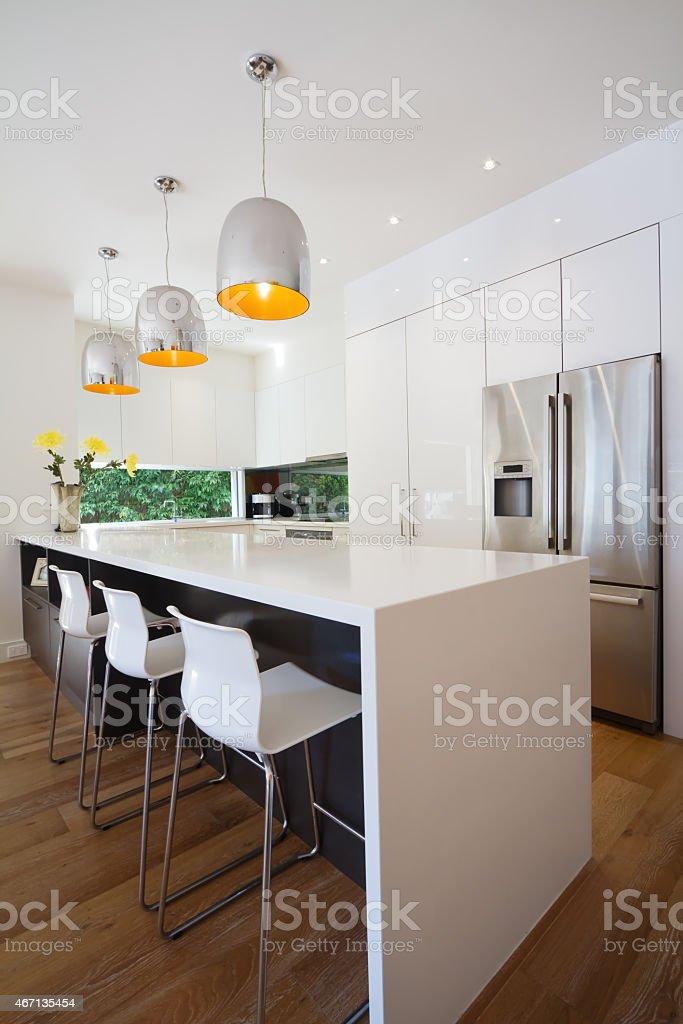 Modern Australian kitchen renovation with waterfall island bench stock photo