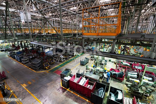 849023956istockphoto Modern automatic automobile manufacturing workshop. A busy car production line. Industrial scenery background. 1168959474