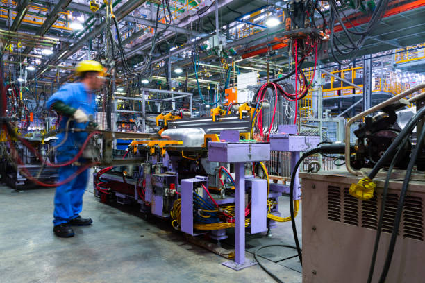 Modern automatic automobile manufacturing workshop. A busy car production line. Industrial scenery background. Modern automatic automobile manufacturing workshop. A busy car production line. Industrial scenery background. manufacturing stock pictures, royalty-free photos & images