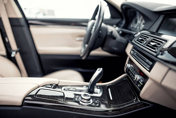 modern automatic transmission and gear stick, steering wheel and dashboard - car interior stock photos and pictures