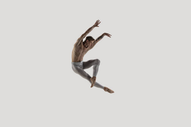 Modern ballet dancer. Contemporary art ballet. Young flexible athletic man. stock photo