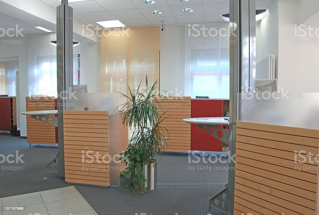 Modern bank counters with wooden accents stock photo