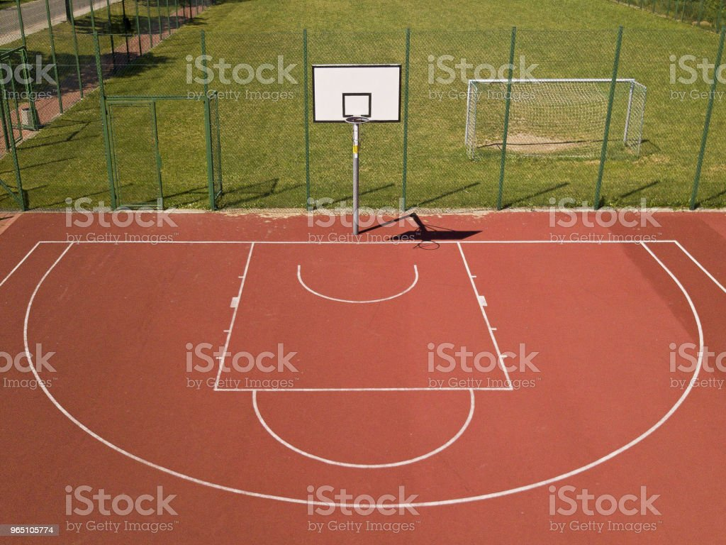 Modern basketball court in the courtyard on the centre of municipal sports and recreation. zbiór zdjęć royalty-free