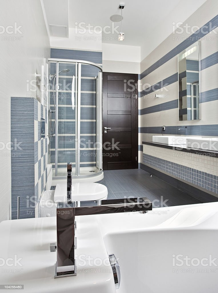 Modern bathroom in blue and gray tones with shower cubicle royalty-free stock photo