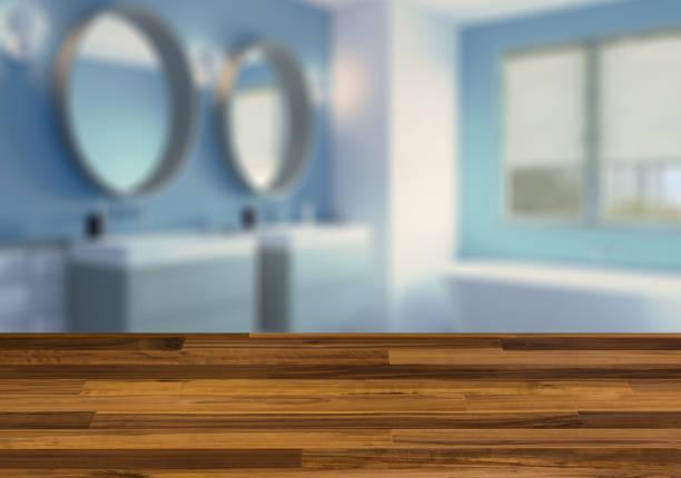 Casa de banho moderna incluindo banho e pia.  Mesa de madeira. - foto de acervo