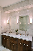 Interior of modern bathroom in private North American home. Variety of high end finishes and modern bathroom hardware.