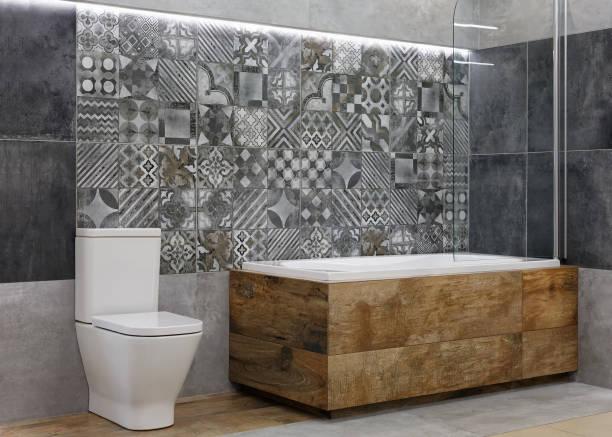 Modern bathroom interior with bathtub and shower stock photo