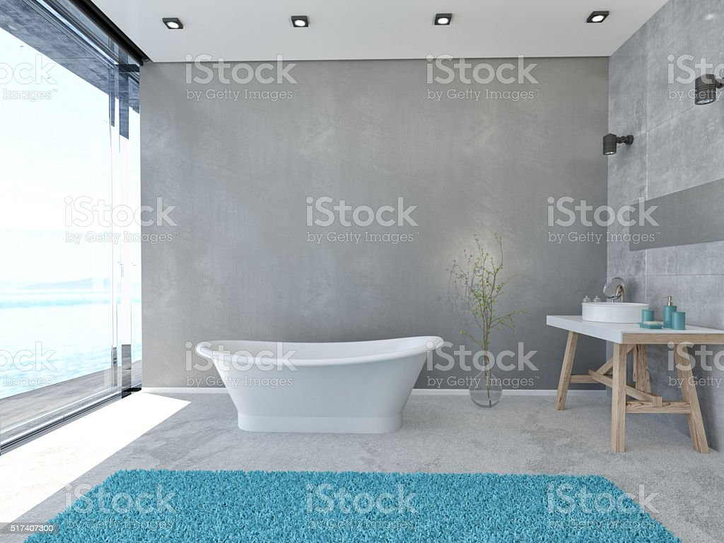 Modern bathroom interior with windows on cloudscape the sea stock photo