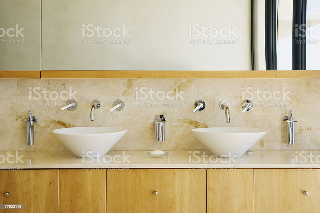 Modern bathroom vanity and sinks stock photo