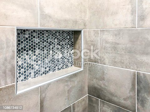Modern bathroom wall porcelain tiles in gray color tone with custom decorative rectangular wall niche for shampoo and soap