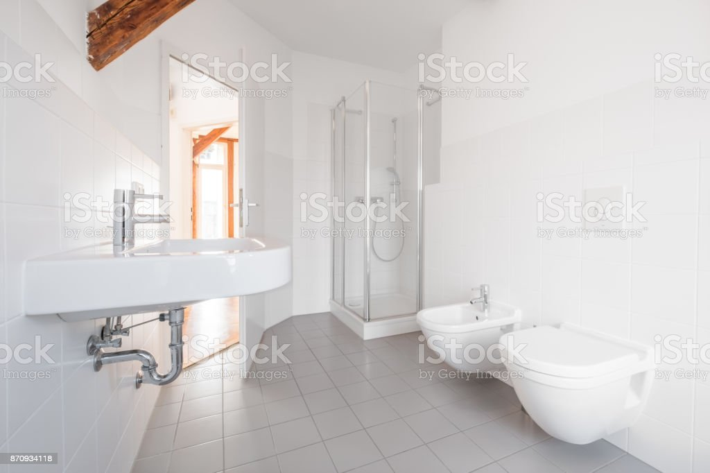 modern bathroom - white tiled bath with shower stock photo