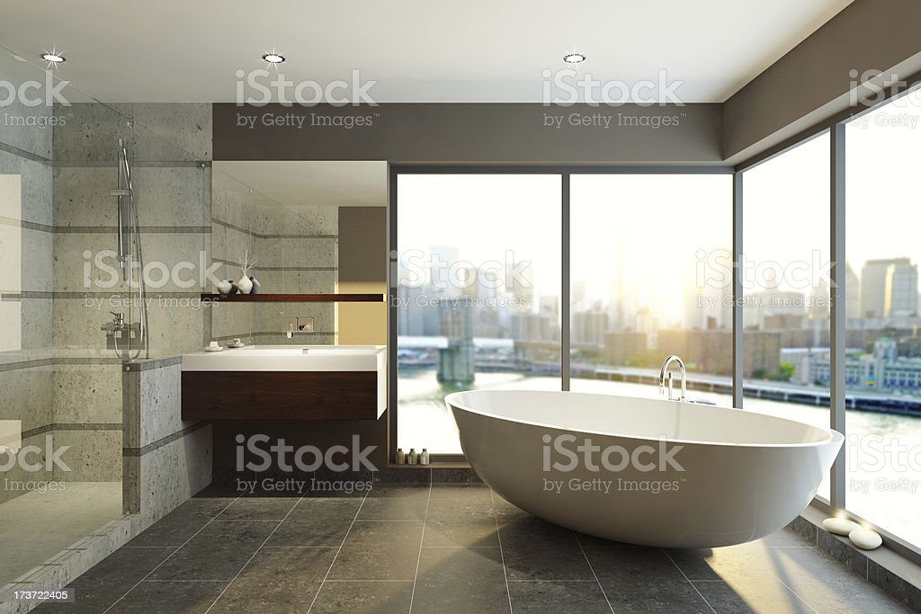 Modern bathroom with city skyline views stock photo