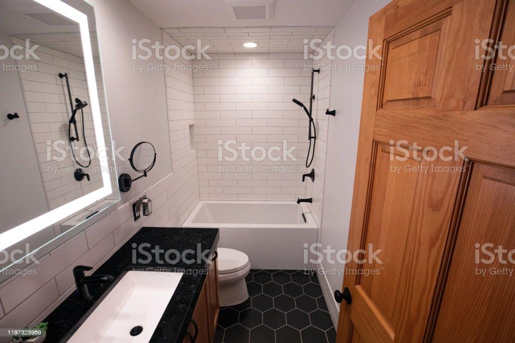 Modern Bathroom With Deep Bathtub And Black Hexagonal Floor Tiles And Matte Black Fixtures Stock Photo Download Image Now Istock
