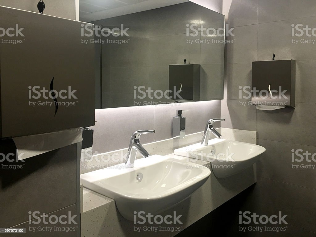 modern bathroom with double basin and grey floor stock photo
