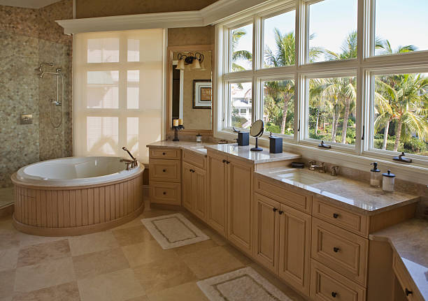 Modern bathroom with forest view stock photo