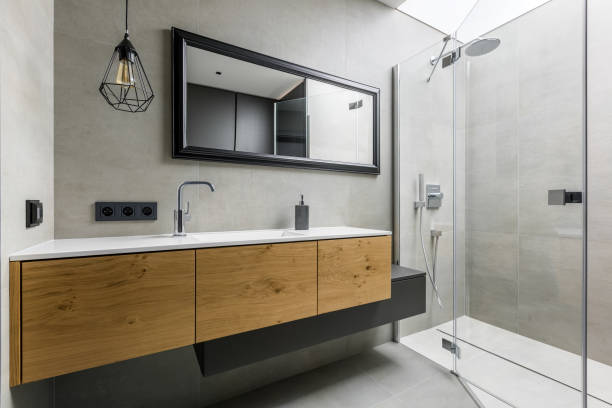 Modern bathroom with shower Modern, gray bathroom with walk in shower, mirror and countertop basin domestic bathroom stock pictures, royalty-free photos & images