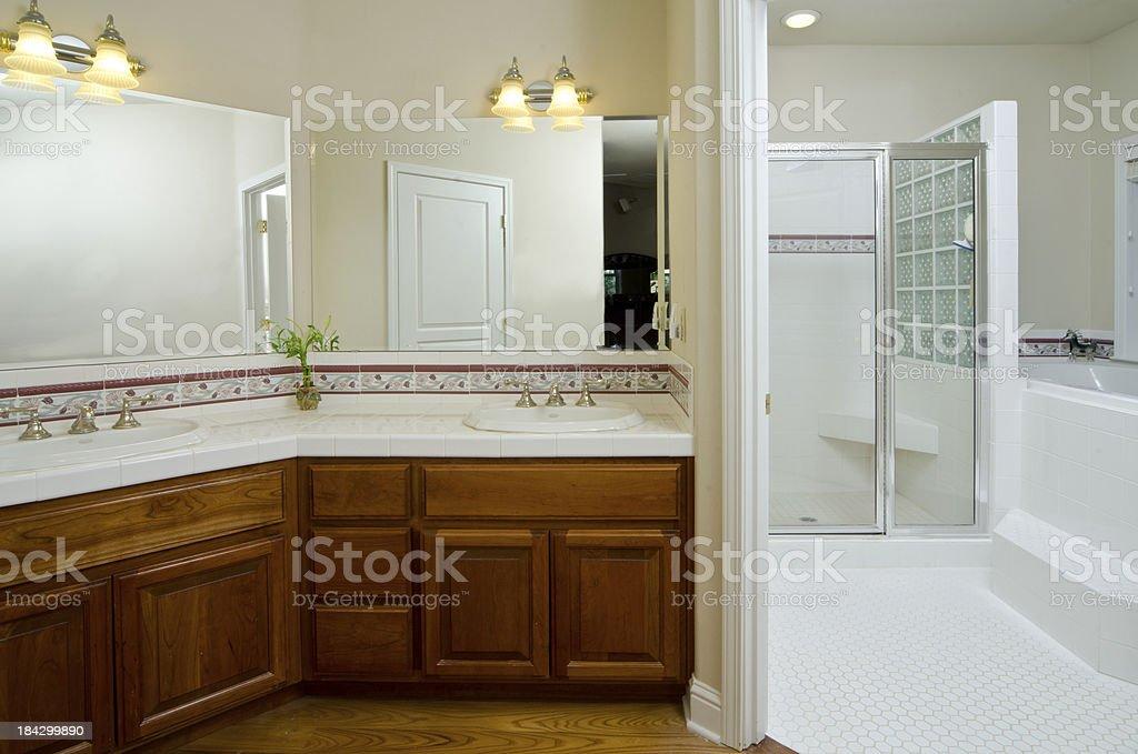 Modern bathroom with sunken bathtub and shower stock photo