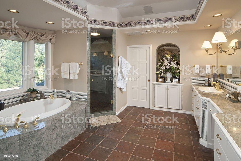 Modern bathroom with sunken bathtub royalty-free stock photo
