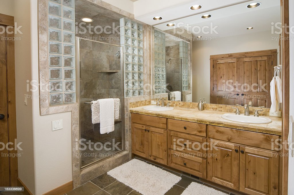 Modern bathroom with tile shower and floor stock photo