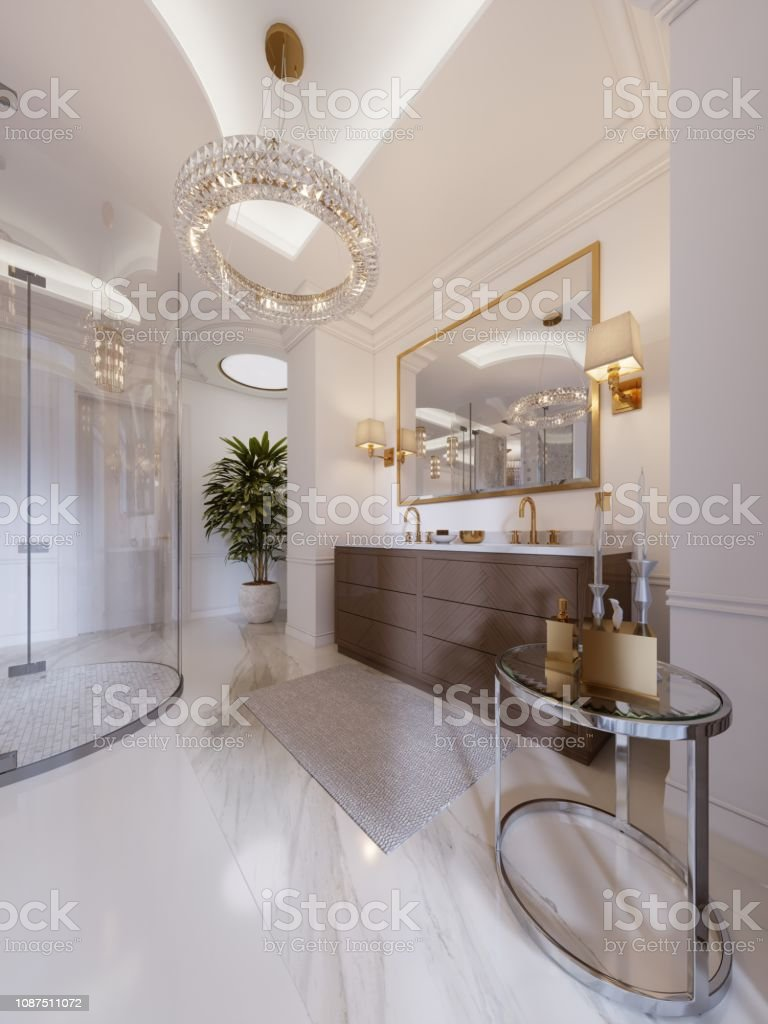 Modern Bathroom With Vanity And A Mirror In A Gold Frame With Sconces On The Wall A Low Table With Decor Shower And A Fashionable Bath Stock Photo Download Image Now