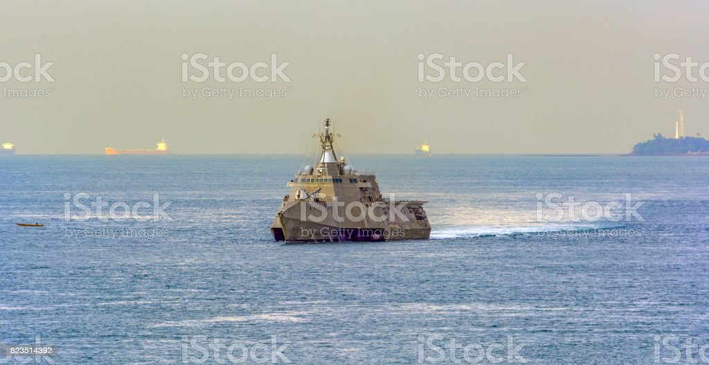 Modern battleship in Singapore Strait. stock photo
