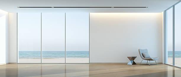 Modern beach house interior, Relaxing sea view living room bildbanksfoto