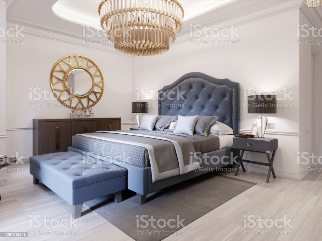 Picture of: Modern Bed In Classic Blue Style With Bedside Table And Lamp Large Glass Chandelier Over A Dresser With A Decor And A Golden Mirror Above Modern Bedroom Stock Photo Download Image