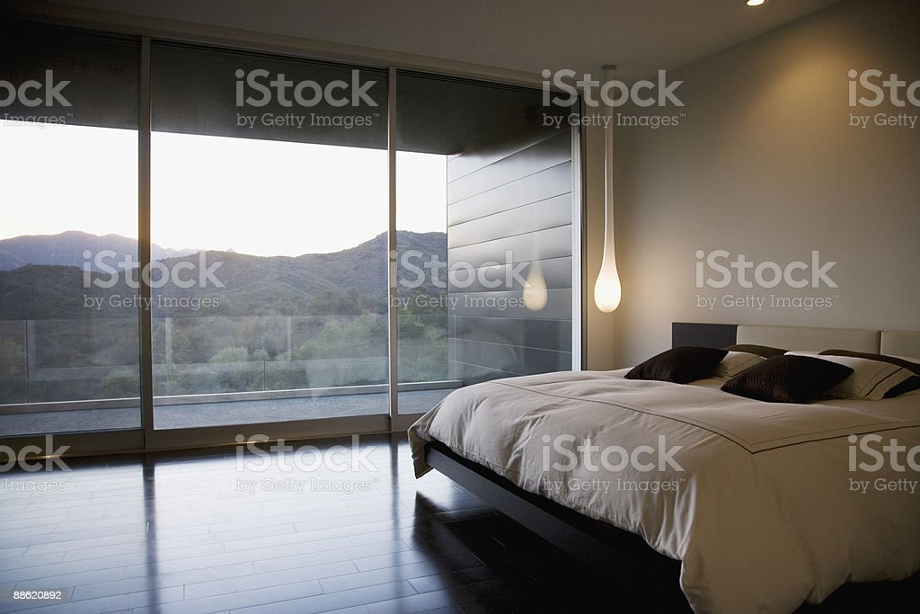 Modern bedroom and glass wall stock photo