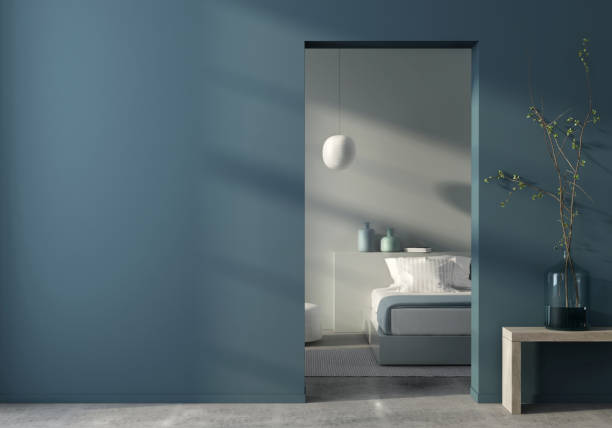 Modern bedroom interior and blue wall 3D illustration. Modern interior in blue with a view of the bedroom through the doorway doorway stock pictures, royalty-free photos & images