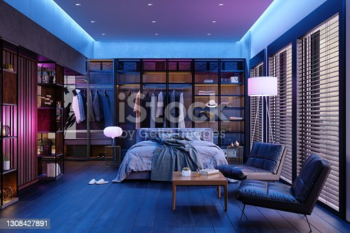 istock Modern Bedroom Interior At Night With Neon Light. Messy Bed, Clothes In Closet, Armchairs And Floor Lamp. 1308427891
