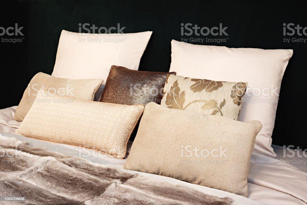 Modern bedroom interior design. Large bed, room with black color...