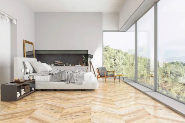 modernes schlafzimmer interieur mit naturblick - schlafzimmer stock-fotos und bilder