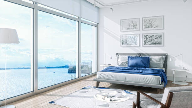 Modern Bedroom Interior With Sea View Interior of a modern bedroom with beautiful sea view. luxury hotel room stock pictures, royalty-free photos & images