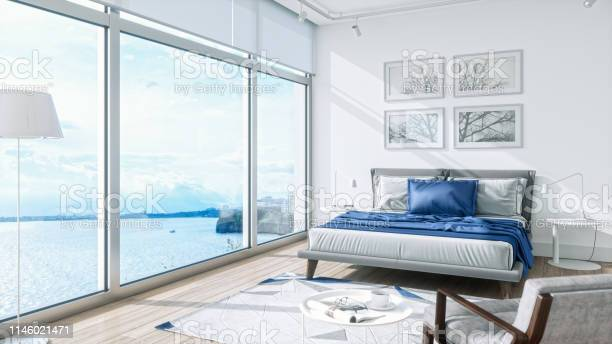 Photo of Modern Bedroom Interior With Sea View