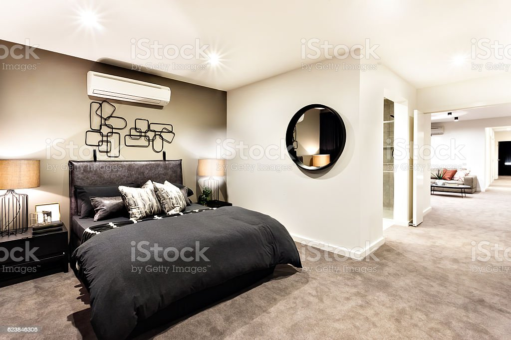 Modern bedroom with a hallway to other rooms stock photo