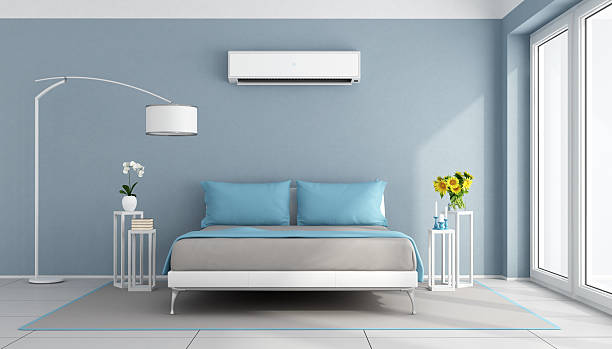 Modern bedroom with air conditioner stock photo