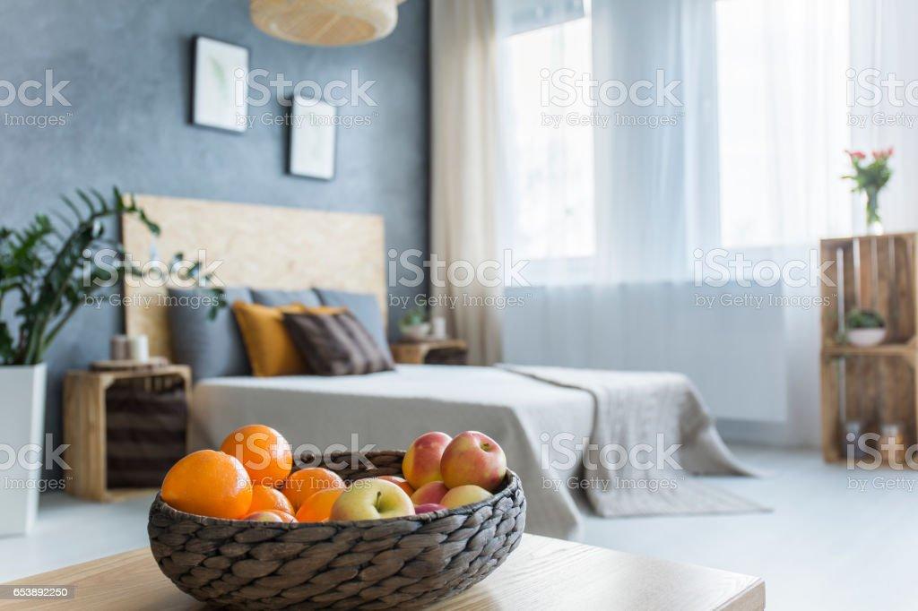 Modern bedroom with fruit basket stock photo